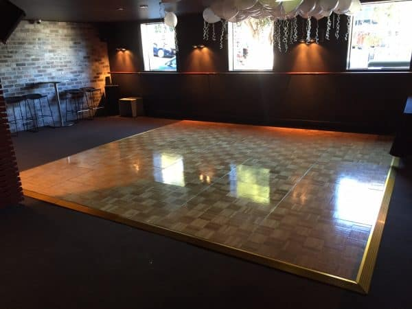 parquetry wooden dance floor set up in a venue