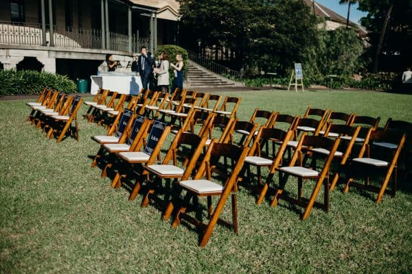 Walnut Chairs for hire set up theatre style on lawn