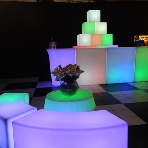 illuminated bar and benches setting arouns black and white dance floor
