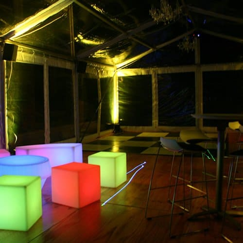 Glow furniture in marquee at night