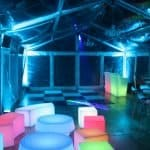glow bar, cubes and benches in marquee with clear roof and sides