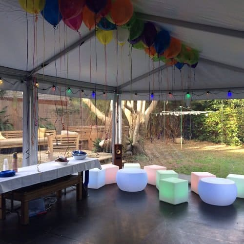 glow furniture in marquee with balloons and table
