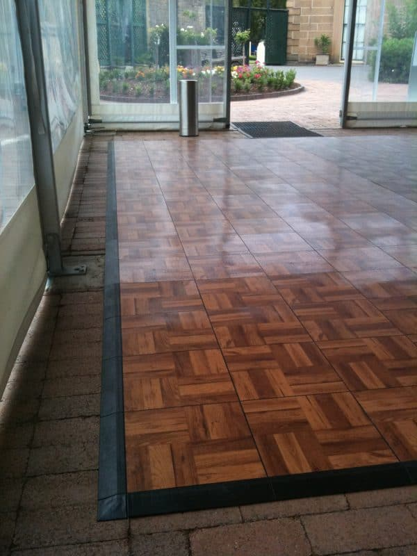Wooden parquetry floor inside marquee