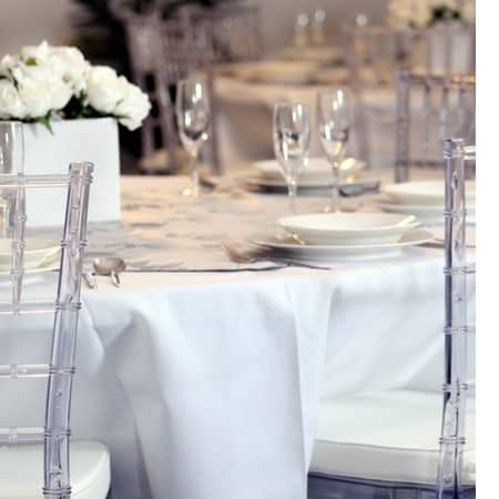 clear tiffany chairs at dinner table