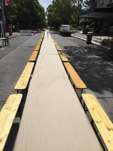 Picnic tables and benches at festival at Hunters Hill