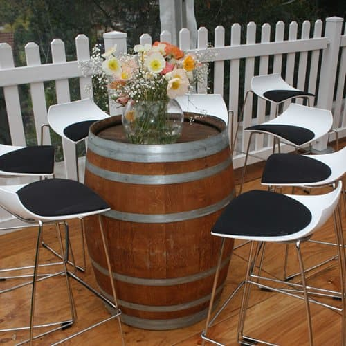 Wine barrel and bar stools in marquee