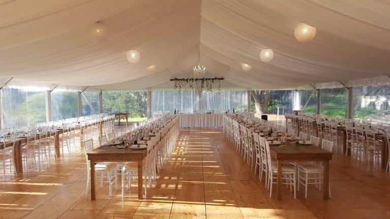 Marquee with dinner setting for wedding