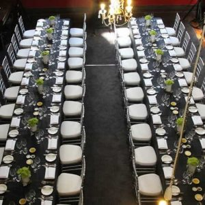silver tiffany chairs at dinner tables 2 rows