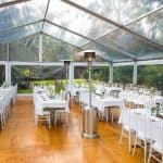 Marquee clear roofs in garden for wedding, rectangle table setting