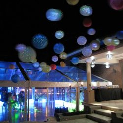 MARQUEE WITH CLEAR ROOFS AT NIGHT WITH LANTERNS
