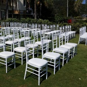 Tiffany chairs in rows at outdoor wedding ceremony