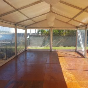 Marquee on timber floor over pool