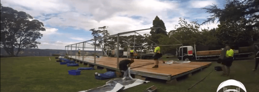Wedding Marquee Hire In The Blue Mountains: Shows the build of a hire marquee - floor and 8 x21m marquee