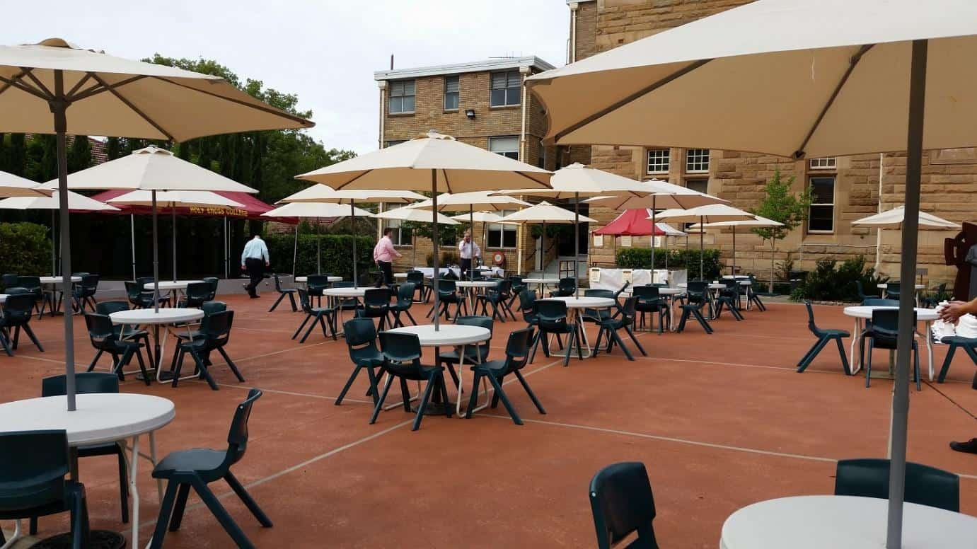 Pictured café tables and market umbrellas at holy cross college ryde