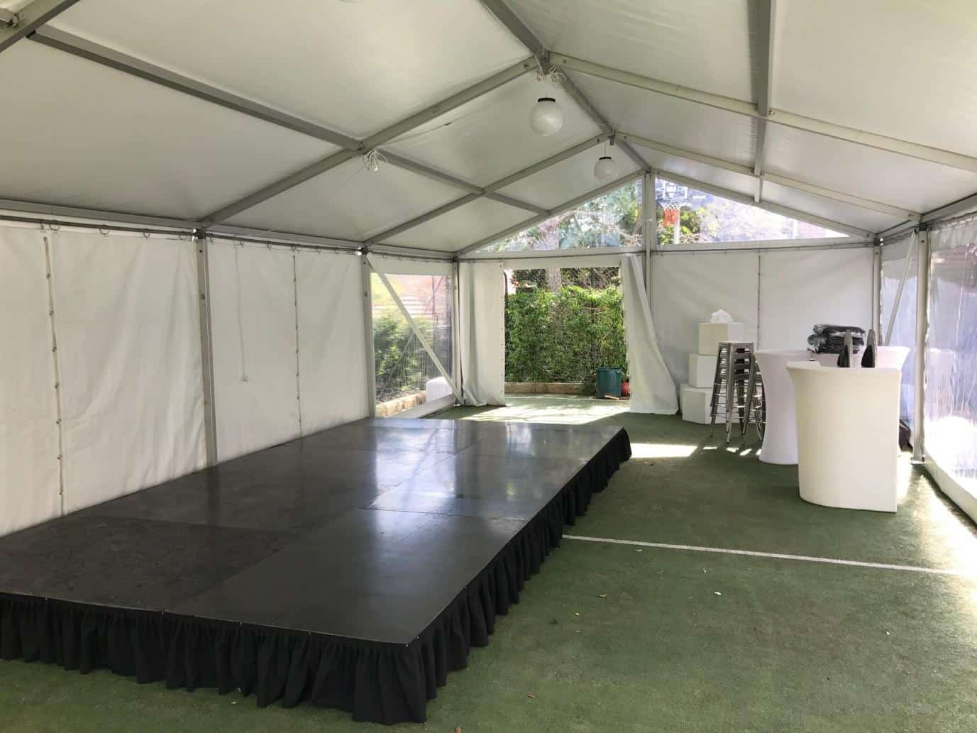 6x15 Marquee hire near mosman with a stage and Glow Furniture