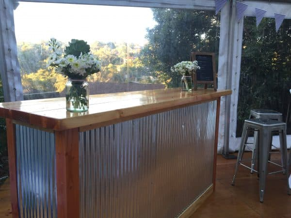Rustic corrugated steel and wooden bar