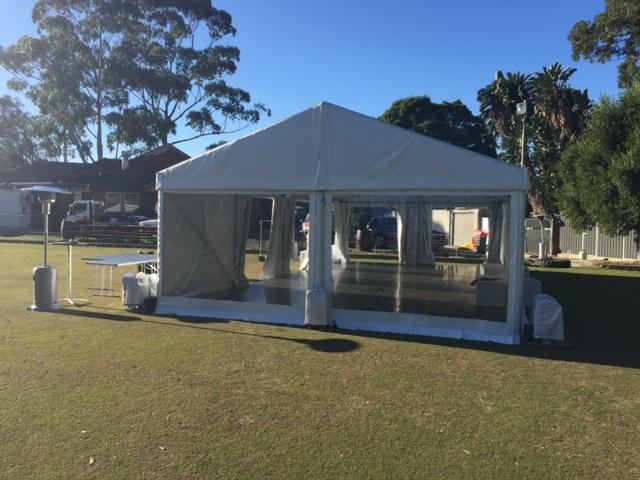 Clear-walled marquee on lawn of the Diddy