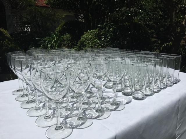 Crystal wine glasses and tumblers on table