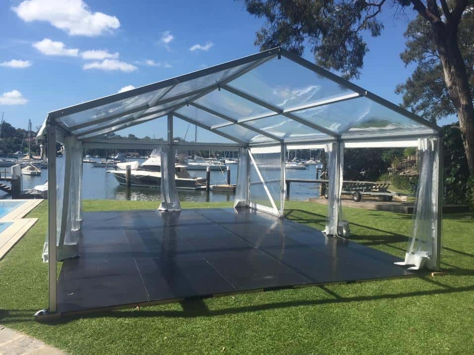 Clear roofed and walled marquee with flooring near Woodford Bay in Longueville