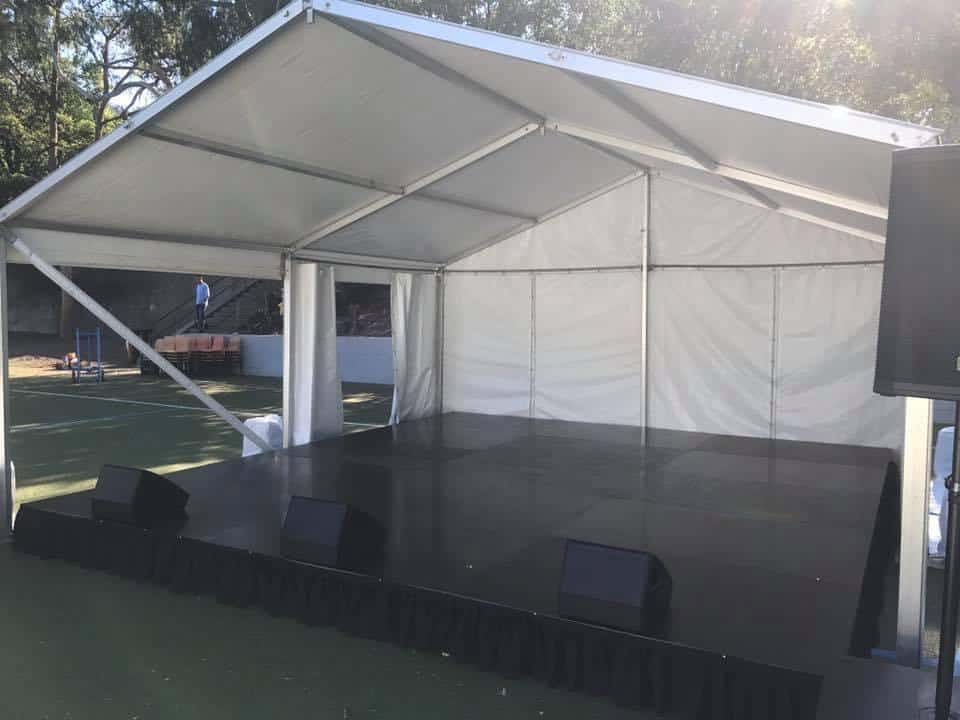 White walled and roofed Marquee and Stage in the Chatswood School grounds